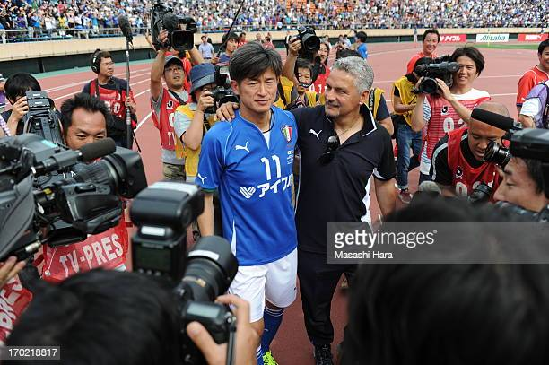Roberto Baggio and Kazuyoshi Miura look on after the JLeague Legend and Glorie Azzurre match at the National Stadium on June 9 2013 in Tokyo Japan