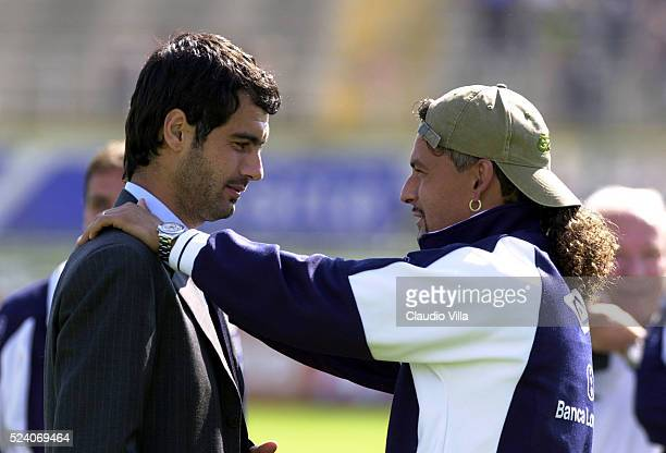 Roberto Baggio of Brescia Calcio and Josep Guardiola of AS Roma chat prior to the Serie A 4th round league match played between Brescia Calcio and AS...