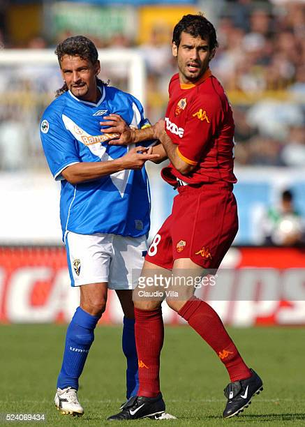 Roberto Baggio of Brescia Calcio and Josep Guardiola of AS Roma during the Serie A 4th round league match played between Brescia Calcio and AS Roma...