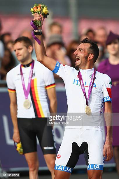 Roberto Bargna of Italy celebrates with his gold medal alongside silver medalist Steffen Warias of Germany after the Men's Individual C 1-3 Road Race...