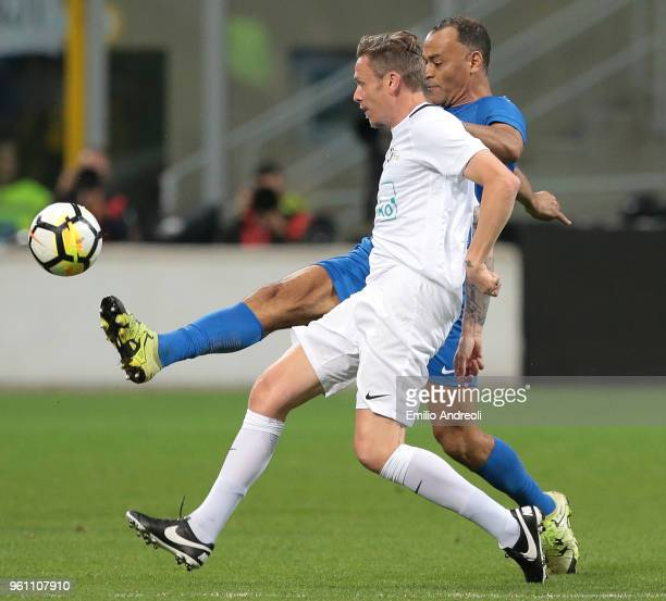 Roberto Baronio is challenged by Marcos Cafu during Andrea Pirlo Farewell Match at Stadio Giuseppe Meazza on May 21 2018 in Milan Italy