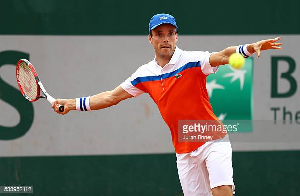 Roberto Baustista Agut of Spain plays a forehand during the Men's Singles first round match against Dimitry Tursunov of Russia on day three of the...