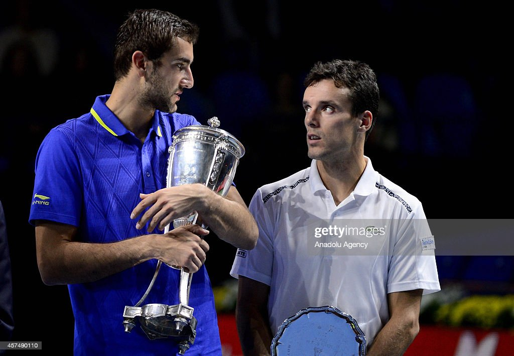 Roberto Bautista Agut of Spain (R) and Marin Cilic of Croatia (L) pose with their trophies after the men's singles final match at the end of the Kremlin Cup 2014 International Tennis Tournament at the Olympic Stadium in Moscow, Russia on October 19, 2014.