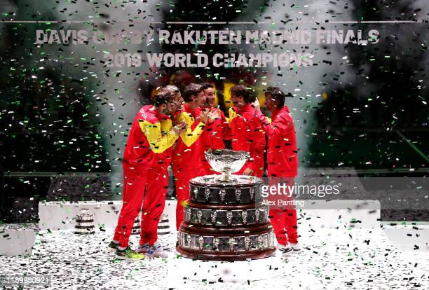 Roberto Bautista Agut of Spain and team mates celebrate with the trophy following victory in the Final between Spain and Canada during Day Seven of...