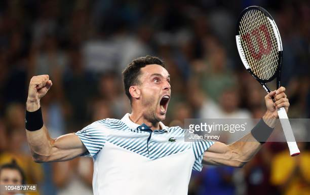 Roberto Bautista Agut of Spain celebrates defeating John Millman of Australia in his second round match during day three of the 2019 Australian Open...