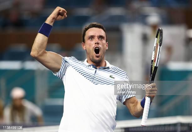 Roberto Bautista Agut of Spain celebrates defeating Novak Djokovic of Serbia during the Miami Open tennis on March 26 2019 in Miami Gardens Florida