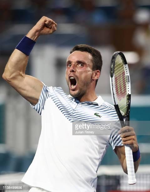 Roberto Bautista Agut of Spain celebrates defeating Novak Djokovic of Serbia during the Miami Open tennis on March 26, 2019 in Miami Gardens, Florida.