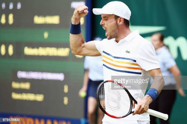 Roberto Bautista Agut of Spain celebrates during his round of 16 match against Robin Hase of Netherlands during day 3 of the Gerry Weber Open at...