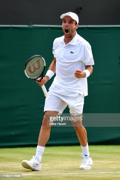 Roberto Bautista Agut of Spain celebrates in his Men's Singles third round match against Karen Khachanov of Russia during Day five of The...