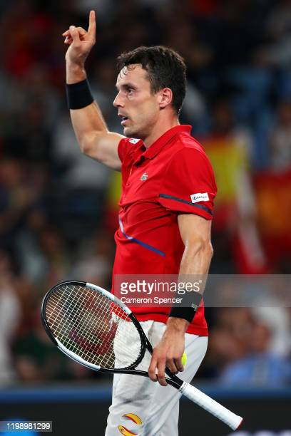 Roberto Bautista Agut of Spain celebrates match point during his final singles match Dusan Lajović of Serbia during day 10 of the ATP Cup at Ken...