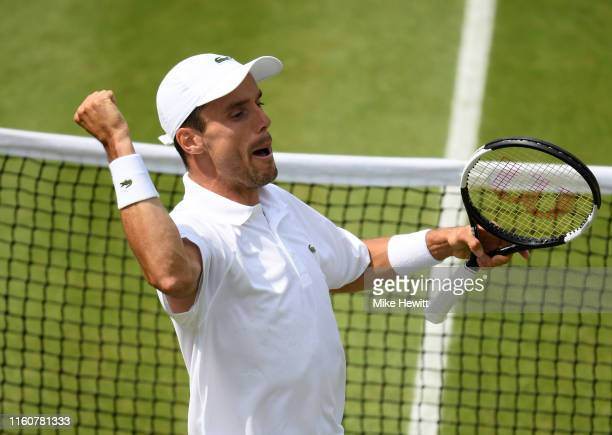 Roberto Bautista Agut of Spain celebrates match point in his Men's Singles fourth round match against Benoit Paire of France during Day Seven of The...