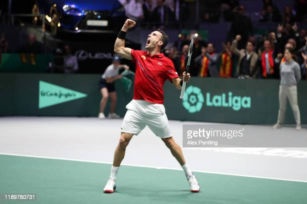 Roberto Bautista Agut of Spain celebrates match point in his singles final match against Felix AugerAliassime of Canada during Day Seven of the 2019...