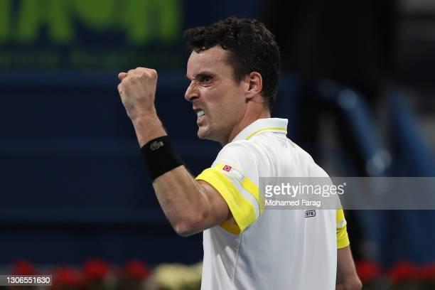 Roberto Bautista Agut of Spain celebrates victory in his quarter final match with Dominic Thiem of Austria in the Qatar ExxonMobil Open at Khalifa...