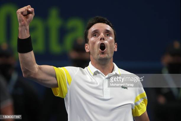 Roberto Bautista Agut of Spain celebrates winning his round of 32 singles match against Reilly Opelka of United States during Day One of the Qatar...