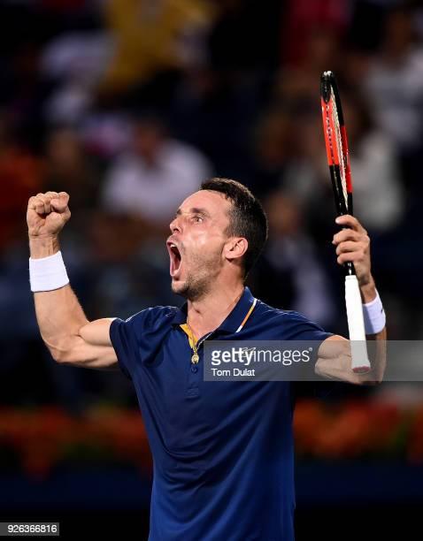 Roberto Bautista Agut of Spain celebrates winning his semi final match against Malek Jaziri of Tunisia on day five of the ATP Dubai Duty Free Tennis...