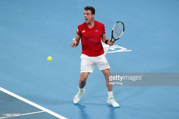 Roberto Bautista Agut of Spain celebrates winning match point during his quarter final singles match against Kimmer Coppejans of Belgium during day...