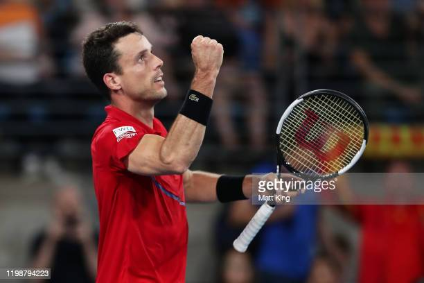 Roberto Bautista Agut of Spain celebrates winning match point during his semi-final singles match against Nick Kyrgios of Australia during day nine...