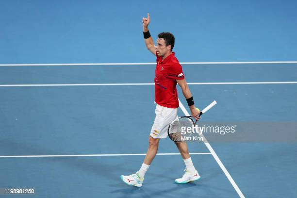 Roberto Bautista Agut of Spain celebrates winning match point during his final singles match against Dusan Lajovic of Serbia during day 10 of the ATP...