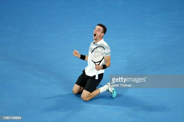 Roberto Bautista Agut of Spain celebrates winning match point in his second round match against John Millman of Australia during day three of the...
