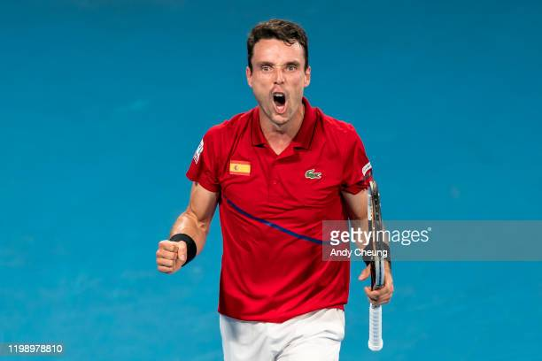 Roberto Bautista Agut of Spain celebrates winning set point during his final singles match against Dusan Lajovic of Serbia during day 10 of the ATP...