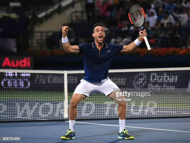 Roberto Bautista Agut of Spain celebrates winning the final match against Lucas Pouille of France on day six of the ATP Dubai Duty Free Tennis...
