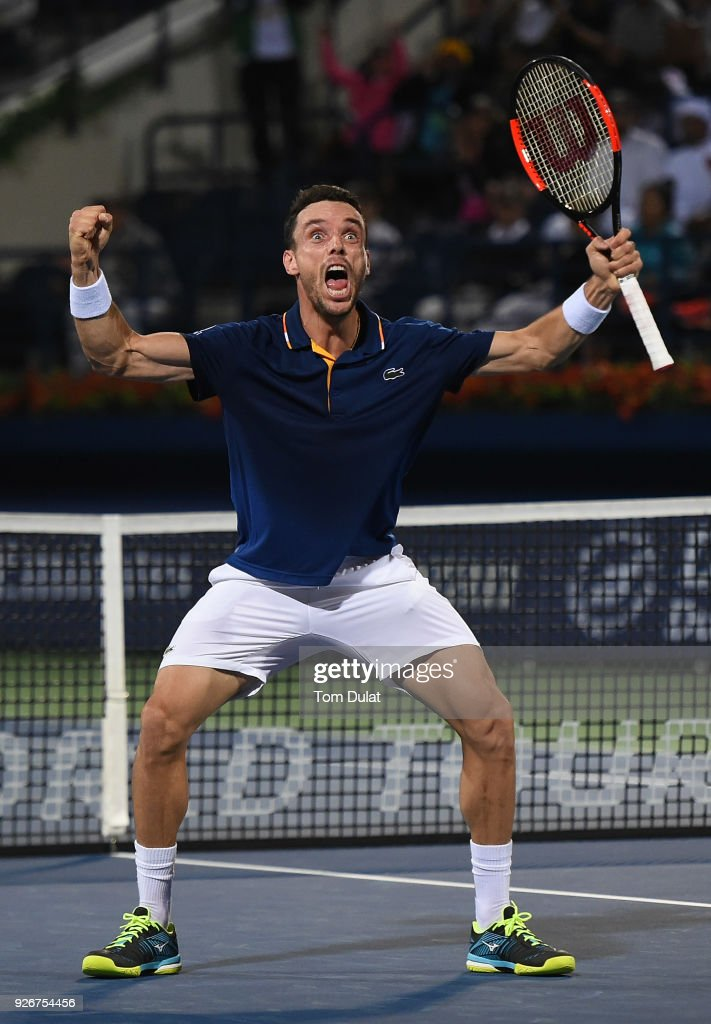 Roberto Bautista Agut of Spain celebrates winning the final match against Lucas Pouille of France on day six of the ATP Dubai Duty Free Tennis Championships at the Dubai Duty Free Stadium on March 3, 2018 in Dubai, United Arab Emirates