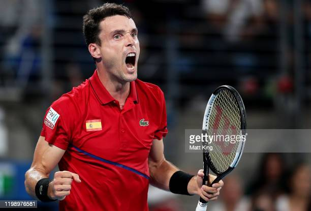Roberto Bautista Agut of Spain celebrates winning the first set during his final singles match against Dusan Lajovic of Serbia during day 10 of the...
