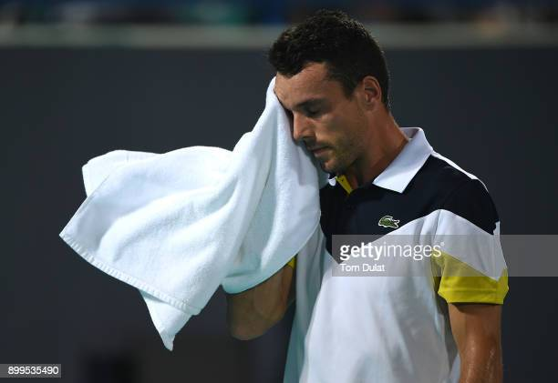 Roberto Bautista Agut of Spain cleans his face during an exhibition match against Andy Murray of Great Britain on day two of the Mubadala World...