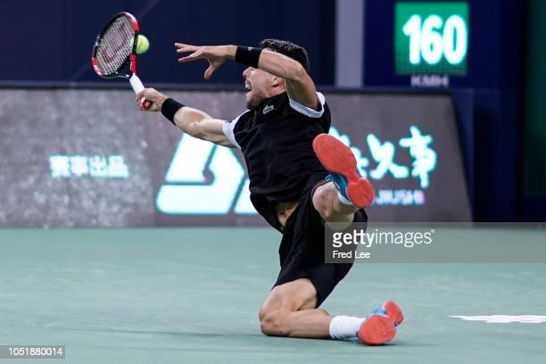 Roberto Bautista Agut of Spain hits a return against Roger Federer of Switzerland during third round of the 2018 Rolex Shanghai Masters on Day 4 at...