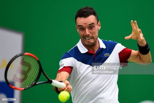 Roberto Bautista Agut of Spain hits a return during the men's singles against Chung Hyeon of South Korea at the Shanghai Masters in Shanghai on...