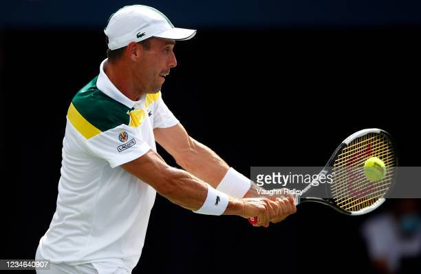 Roberto Bautista Agut of Spain hits a shot against Diego Schwartzman of Argentina during the third round on Day Four of the National Bank Open at...