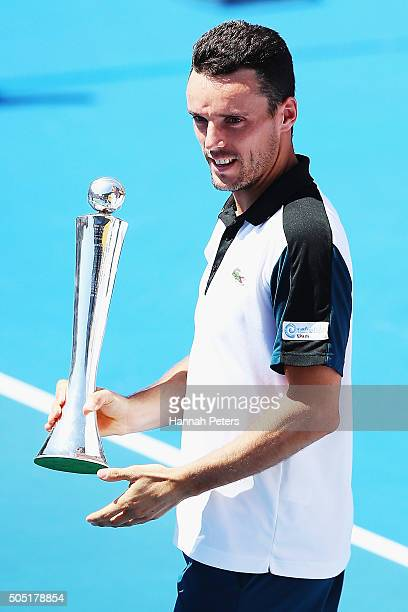 Roberto Bautista Agut of Spain holds up the trophy after winning the men's final match against Jack Sock of USA during day six of the 2016 ASB...