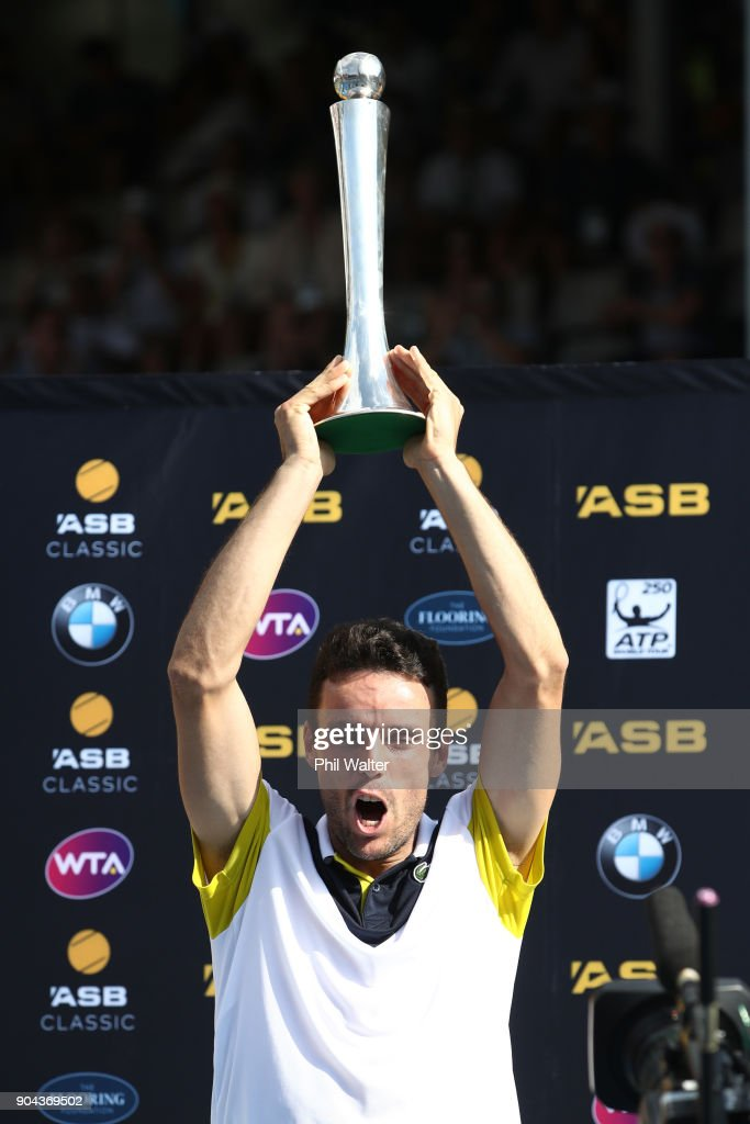 Roberto Bautista Agut of Spain holds up the trophy following his Mens Singles Final win over Juan Martin Del Potro of Argentina during day six of the ASB Men's Classic at ASB Tennis Centre on January 13, 2018 in Auckland, New Zealand.