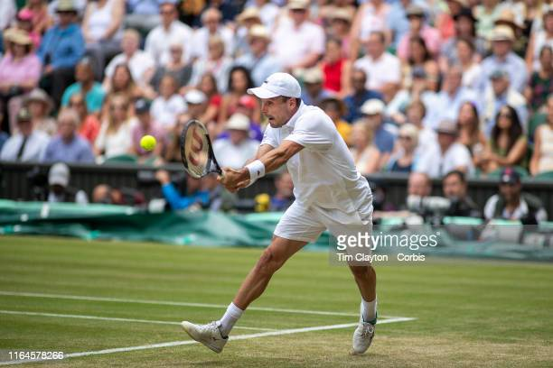 Roberto Bautista Agut of Spain in action against Novak Djokovic of Serbia during the Men's Singles Semifinals on Centre Court during the Wimbledon...