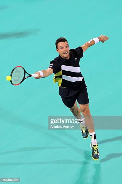 Roberto Bautista Agut of Spain in action during his final match against Kevin Anderson of South Africa on day three of the Mubadala World Tennis...
