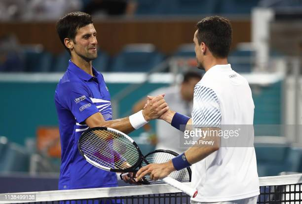 Roberto Bautista Agut of Spain is congratulated by Novak Djokovic of Serbia after their match during the Miami Open tennis on March 26 2019 in Miami...