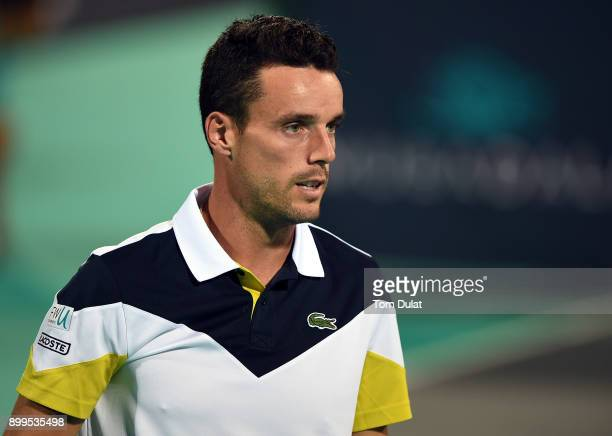 Roberto Bautista Agut of Spain looks on during his exhibition match against Andy Murray of Great Britain on day two of the Mubadala World Tennis...