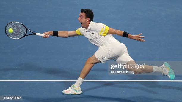 Roberto Bautista Agut of Spain lunges for a forehand during his quarter final match with Dominic Thiem of Austria in the Qatar ExxonMobil Open at...