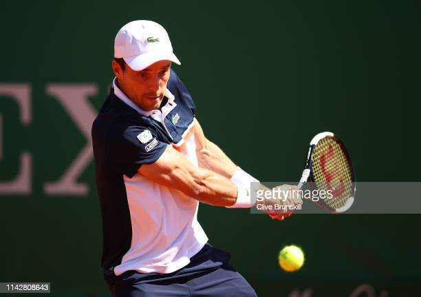 Roberto Bautista Agut of Spain plays a backhand against John Millman of Australia in their first round match during day two of the Rolex MonteCarlo...
