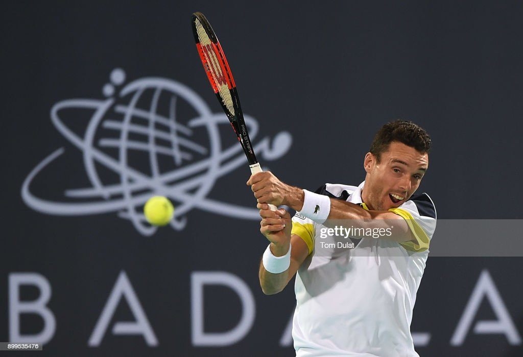 Roberto Bautista Agut of Spain plays a backhand during his exhibition match against Andy Murray of Great Britain on day two of the Mubadala World Tennis Championship at International Tennis Centre Zayed Sports City on December 29, 2017 in Abu Dhabi, United Arab Emirates.