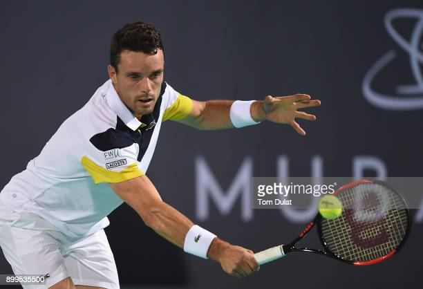 Roberto Bautista Agut of Spain plays a backhand during his exhibition match against Andy Murray of Great Britain on day two of the Mubadala World...
