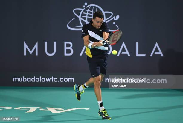 Roberto Bautista Agut of Spain plays a backhand during his final match against Kevin Anderson of South Africa on day three of the Mubadala World...