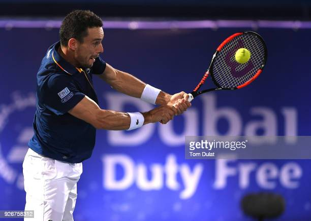 Roberto Bautista Agut of Spain plays a backhand during his final match against Lucas Pouille of France on day six of the ATP Dubai Duty Free Tennis...