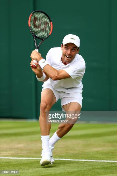 Roberto Bautista Agut of Spain plays a backhand during the Gentlemen's Singles first round match against Andreas HaiderMaurer of Austria on day one...