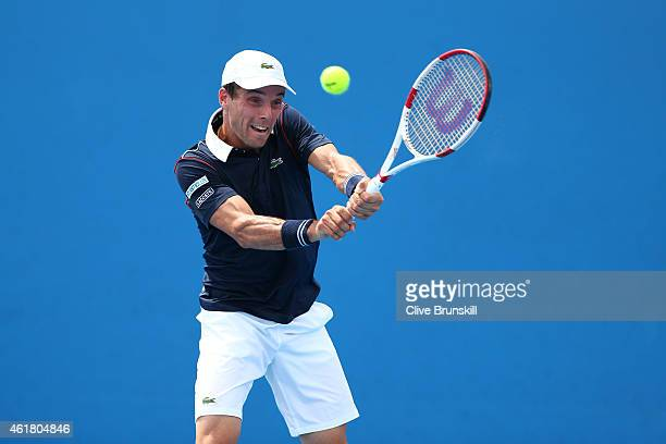 Roberto Bautista Agut of Spain plays a backhand in his first round match against Dominic Thiem of Austria during day two of the 2015 Australian Open...