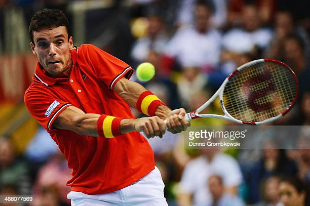 Roberto Bautista Agut of Spain plays a backhand in his match against Philipp Kohlschreiber of Germany on day 1 of the Davis Cup First Round match...