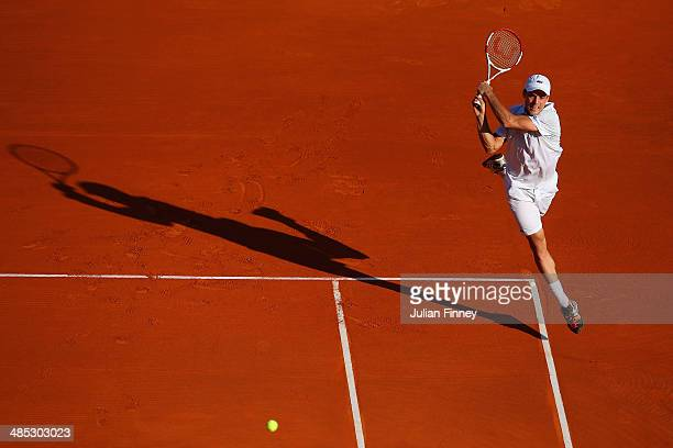 Roberto Bautista Agut of Spain plays a backhand with partner Andreas Seppi of Italy against Romain Arneodo and Benjamin Balleret of Monaco in their...
