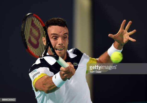 Roberto Bautista Agut of Spain plays a forehand during his exhibition match against Andy Murray of Great Britain on day two of the Mubadala World...