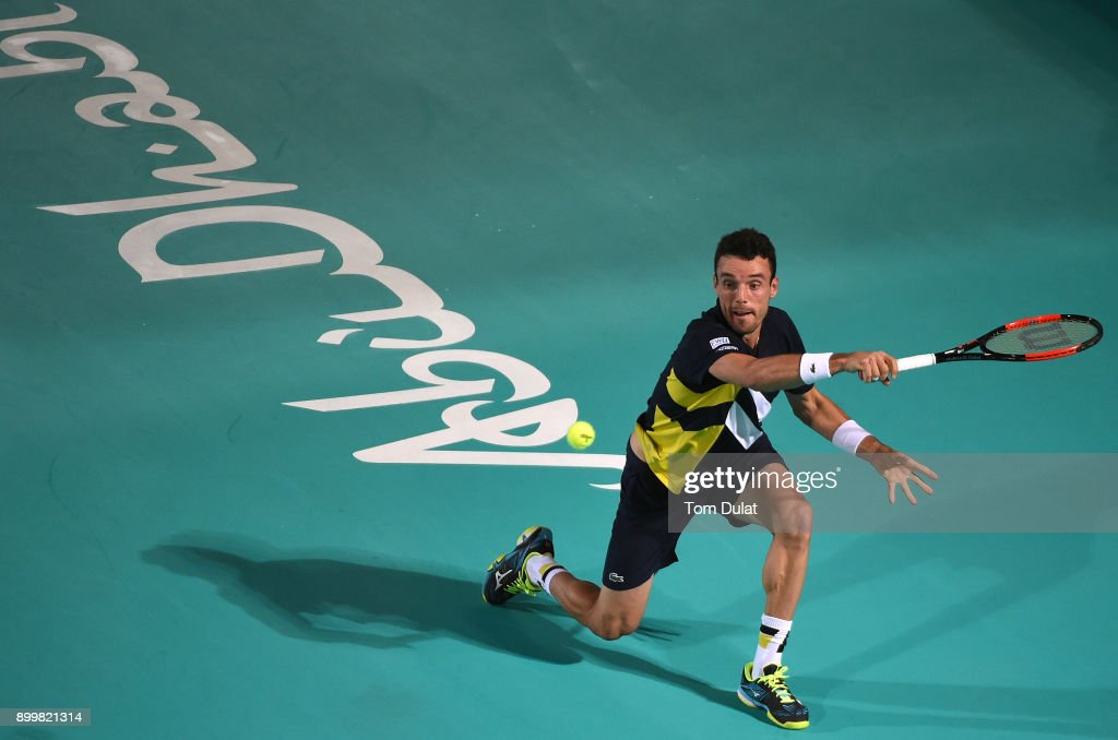 Roberto Bautista Agut of Spain plays a forehand during his final match against Kevin Anderson of South Africa on day three of the Mubadala World Tennis Championship at International Tennis Centre Zayed Sports City on December 30, 2017 in Abu Dhabi, United Arab Emirates.