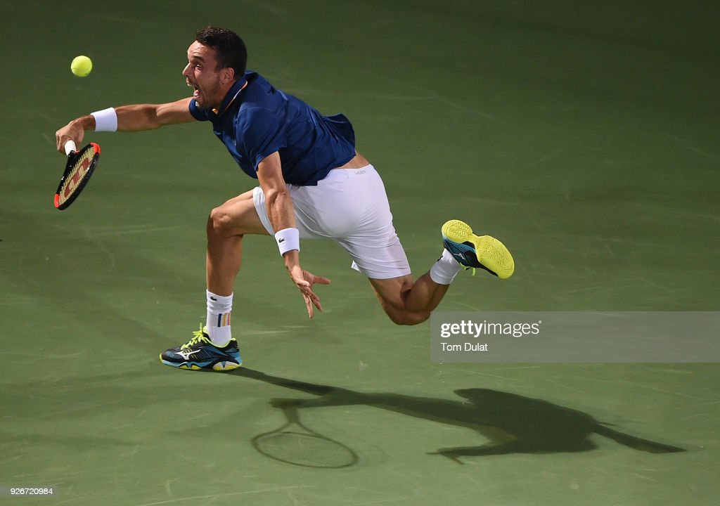 Roberto Bautista Agut of Spain plays a forehand during his final match against Lucas Pouille of France on day six of the ATP Dubai Duty Free Tennis Championships at the Dubai Duty Free Stadium on March 3, 2018 in Dubai, United Arab Emirates